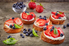 Toasted bread with cream cheese and berries Stock Photos
