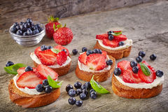 Toasted bread with cream cheese and berries Stock Images
