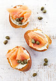 Toasted bread with cream cheese and salmon fillet royalty free stock photos
