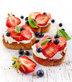 Toasted bread with cream cheese and strawberries royalty free stock photography