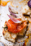 Toasted bread with crushed baked tomato Royalty Free Stock Photo