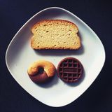 Toasted Bread, Donut, and Chocolate on Top of White Ceramic Plate Royalty Free Stock Photography