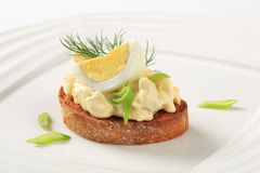 Toasted bread and egg spread Stock Photography