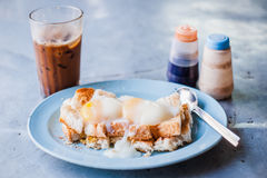 Toasted bread with half-boiled eggs Stock Photos