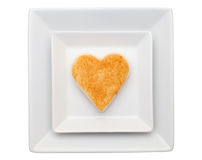 Toasted bread with heart. In plate isolated on white background Royalty Free Stock Photos