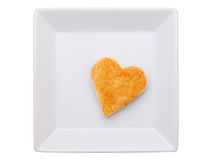 Toasted bread with heart shape. In plate,  isolated on white background Royalty Free Stock Photo