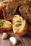 Toasted bread with herbs and garlic closeup on paper. Vertical Royalty Free Stock Photo