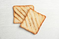 Toasted bread on light background. Top view Stock Photos