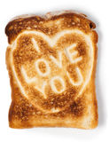 Toasted bread with love message. Toasted bread with I love you message. Isolated on white. Clipping path Royalty Free Stock Photos