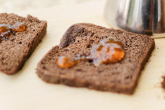 Toasted bread with marmalade. Photograph of some toasted bread with marmalade and other ingredients stock image