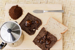 Toasted bread with marmalade. Photograph of some toasted bread with marmalade and other ingredients royalty free stock photo