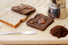 Toasted bread with marmalade. Photograph of some toasted bread with marmalade and other ingredients royalty free stock photography