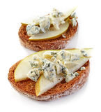 Toasted bread with pear and blue cheese Royalty Free Stock Photography