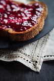 Toasted bread with raspberry jam Royalty Free Stock Photos