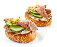 Toasted bread with roast beef and cucumber Royalty Free Stock Images