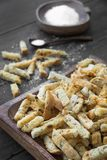 Toasted bread rusks with sault. On a dark wooden rustic background Stock Photos