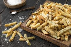 Toasted bread rusks with sault. On a dark wooden rustic background Royalty Free Stock Images