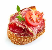 Toasted bread with salami and tomato Royalty Free Stock Images