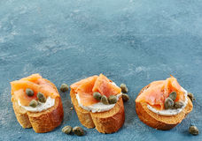 Toasted bread with salmon fillet and cream cheese Royalty Free Stock Images