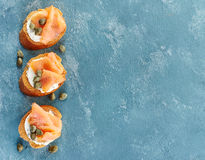 Toasted bread with salmon fillet and cream cheese Stock Images