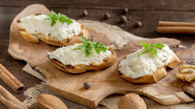 Toasted bread with a salted codfish mousse. On wooden cutting board Stock Photography