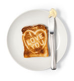 Toasted bread says I love you Royalty Free Stock Photos