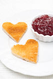 Toasted bread in the shape of heart with berry jam, close-up Stock Images