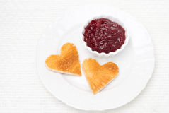 Toasted bread in the shape of heart with berry jam Royalty Free Stock Photos