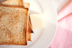 Toasted bread slices with butter pat for breakfast royalty free stock image