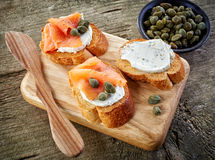 Toasted bread slices with cream cheese and smoked salmon Royalty Free Stock Photo