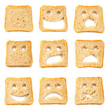 Toasted bread slices with funny faces Royalty Free Stock Photos