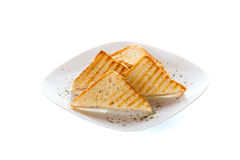Toasted bread slices over white Royalty Free Stock Photography