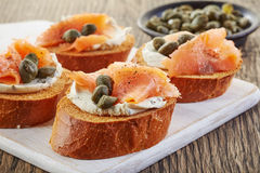 Toasted bread with smoked salmon Royalty Free Stock Photography