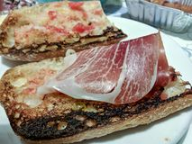 Toasted bread with spanish ham.  Royalty Free Stock Photography
