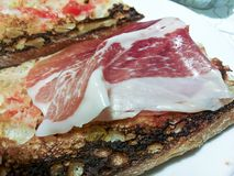 Toasted bread with spanish ham.  Stock Image