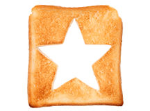 Toasted bread with star shape. Toasted slice of bread with hole star shape Royalty Free Stock Image