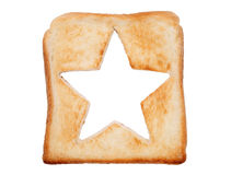 Toasted bread with star shape. Toasted slice of bread with hole star shape Royalty Free Stock Images