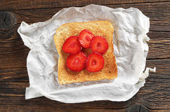 Toasted bread with strawberries Stock Images