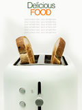 Toasted bread and toaster for breakfast. Royalty Free Stock Photography
