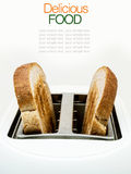Toasted bread and toaster for breakfast. Royalty Free Stock Images