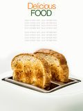 Toasted bread and toaster for breakfast. Stock Images