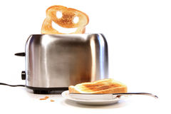 Toasted bread with toaster on white Stock Photo
