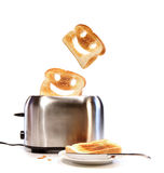 Toasted bread with toaster on white. Background Royalty Free Stock Photo