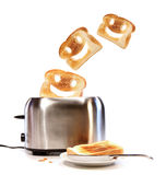 Toasted bread with toaster on white. Background Stock Photo