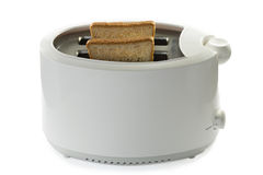 Toasted bread and toaster. On white background isolated with clipping path Stock Photo