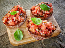 Toasted bread with tomato and basil Stock Photography