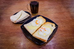 Toasted Breads. On plates with half-boiled egg on it royalty free stock image