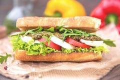 Toasted Caprese Sandwich. With tomato mozzarella arugula and pesto Stock Photos