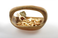 Toasted cashews in a wood bowl. Stock Image