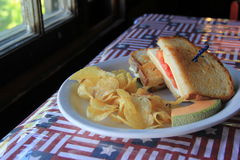 Toasted cheese and chips on patriotic tablecloth Royalty Free Stock Image